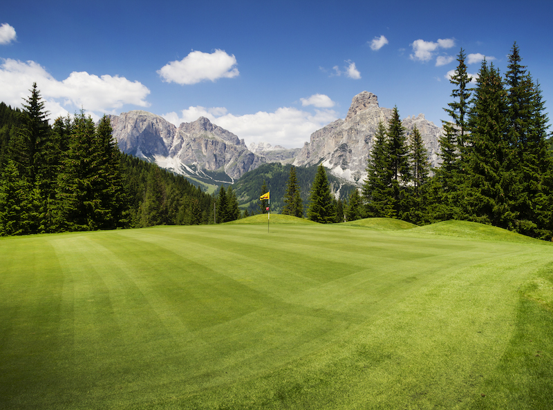 golf course along mountains