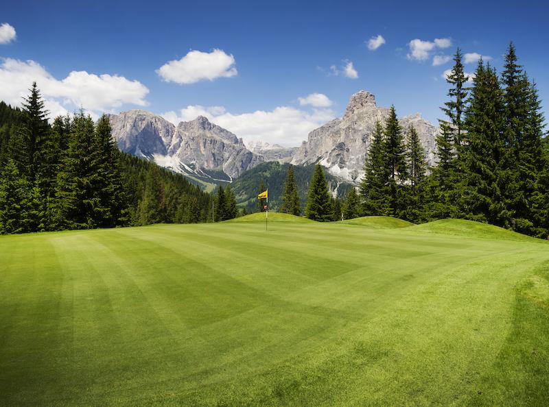 golf course along mountains