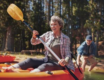 Woman kayaking on Mammoth Lakes, CA