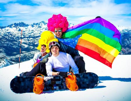 Friends on Mammoth Mountain with colorful flags and attire