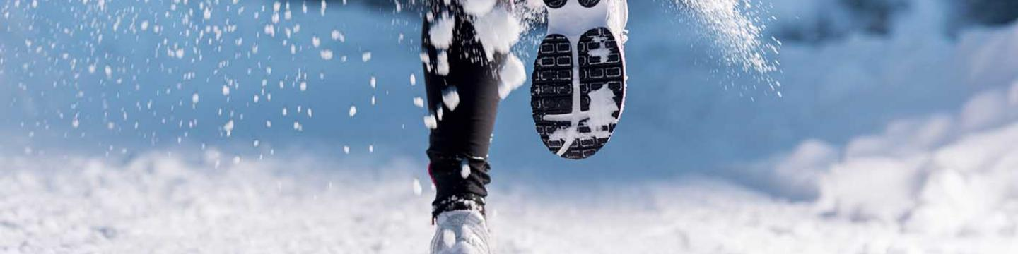 Runner's feet as she competes in a Thanksgiving Day race