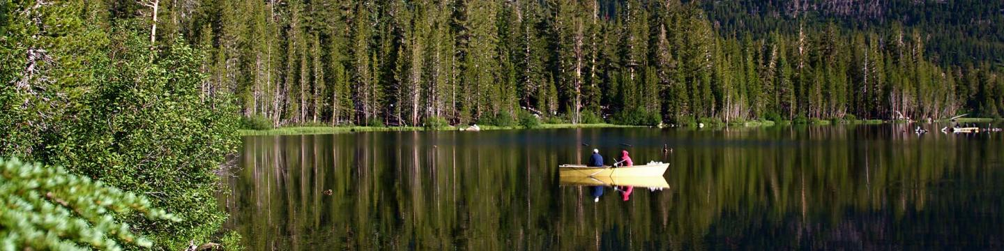 Couple kayaking outside on the water near Mammoth Lakes
