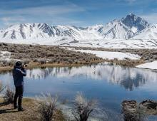Photographer taking photos of the mountain in Mammoth