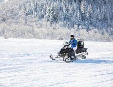 Guy enjoying a snowmobile ride in Mammoth