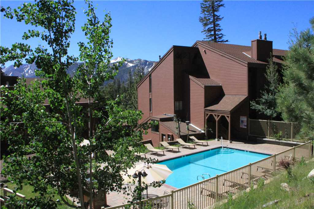 Exterior view of the pool and building at Mammoth Ski & Racquet Club