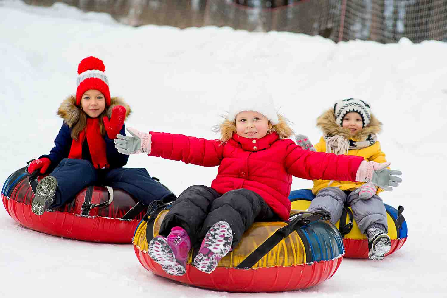 Kids enjoying tubing in Mammoth Lakes, California