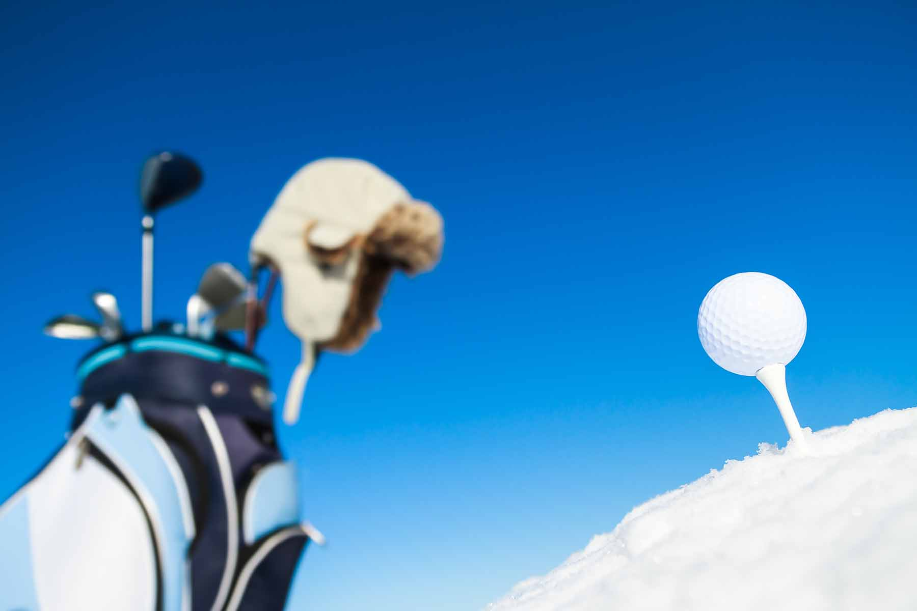 Golf clubs and a golf ball in the winter