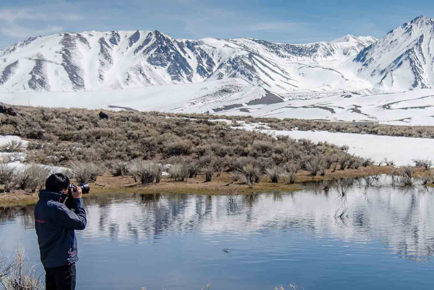 Photographer taking a photo in the winter at Mammoth